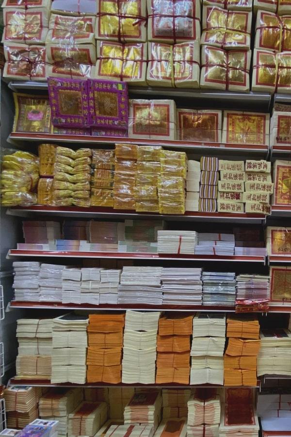 Joss Paper shop storefront display paper money, reincarnation paper and incense paper